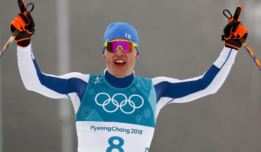 Iivo Niskanen, of Finland, celebrates after winning the gold medal in the men's 50k cross-country skiing competition at the 2018 Winter Olympics in Pyeongchang, South Korea, Saturday, Feb. 24, 2018. (AP Photo/Matthias Schrader)