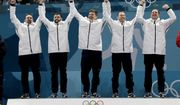 Gold medal winners from left: United States' curlers Joe Polo, John Landsteiner, Matt Hamilton, Tyler George, John Shuster and captain Phill Drobnick celebrate during the men's curling venue ceremony at the 2018 Winter Olympics in Gangneung, South Korea, Saturday, Feb. 24, 2018. (AP Photo/Natacha Pisarenko)