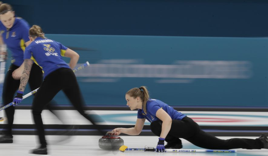 Agnes Knochenhauer, of Sweden, throws during their women's curling final in the Gangneung Curling Centre at the 2018 Winter Olympics in Gangneung, South Korea, Sunday, Feb. 25, 2018. (AP Photo/Aaron Favila)