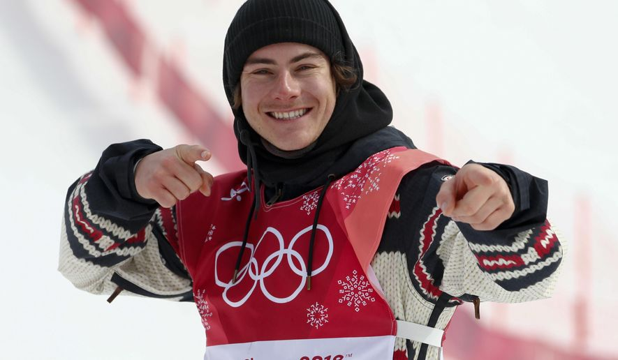 Sebastien Toutant, of Canada, celebrates after winning the gold medal in the men's Big Air snowboard competition at the 2018 Winter Olympics in Pyeongchang, South Korea, Saturday, Feb. 24, 2018. (AP Photo/Matthias Schrader)