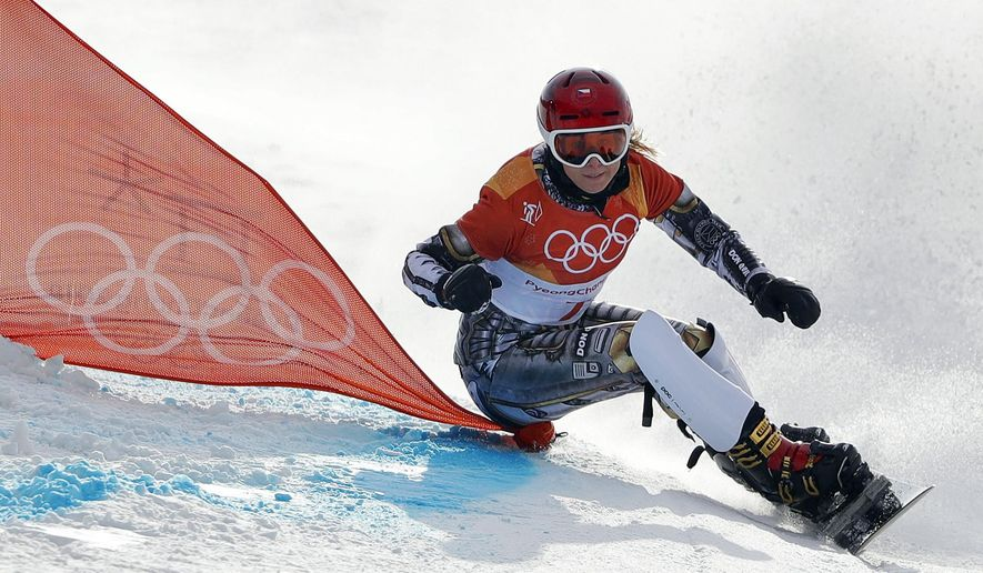 Ester Ledecka, of the Czech Republic, runs the course during the women's parallel giant slalom semifinal at Phoenix Snow Park at the 2018 Winter Olympics in Pyeongchang, South Korea, Saturday, Feb. 24, 2018. (AP Photo/Gregory Bull)