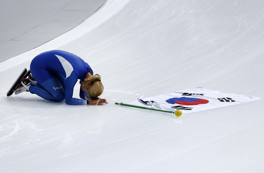 Silver medalist Kim Bo-reum of South Korea celebrates after the women's mass start final speedskating race at the Gangneung Oval at the 2018 Winter Olympics in Gangneung, South Korea, Saturday, Feb. 24, 2018. (AP Photo/Vadim Ghirda)