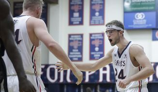 Saint Mary's center Jock Landale, left, and forward Calvin Hermanson (24) celebrate during the first half of an NCAA college basketball game against Santa Clara in Moraga, Calif., Saturday, Feb. 24, 2018. (AP Photo/Jeff Chiu)