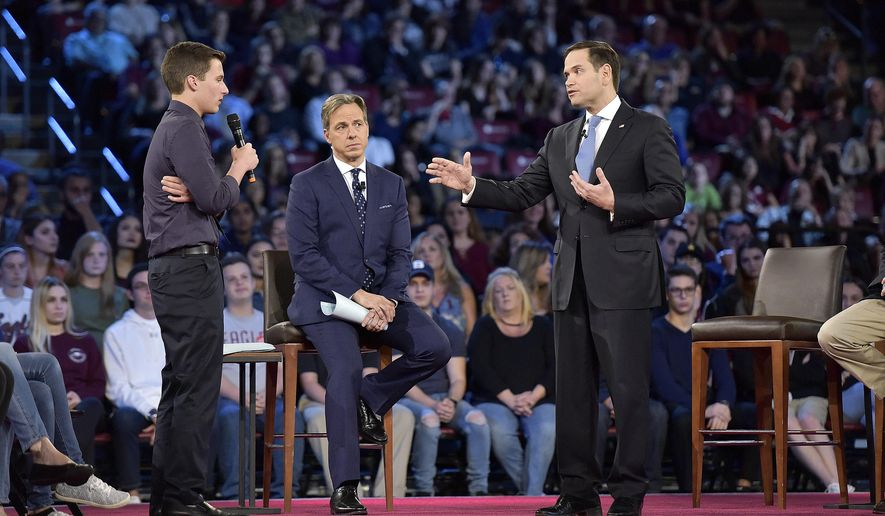 This Feb. 21, 2018 file photo shows Marjory Stoneman Douglas High School student Cameron Kasky, left, asking a question to Sen. Marco Rubio during a CNN town hall meeting in Sunrise, Fla. (Michael Laughlin/South Florida Sun-Sentinel via AP, File)
