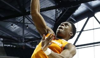 Tennessee forward Admiral Schofield (5) watches his dunk against Mississippi during the first half of an NCAA college basketball game in Oxford, Miss., Saturday, Feb. 24, 2018. (AP Photo/Rogelio V. Solis)