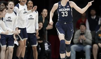 Connecticut guard/forward Katie Lou Samuelson (33) and players on the bench celebrate a 3-point basket by Samuelson against SMU during the second half of an NCAA college basketball game Saturday, Feb. 24, 2018, in Dallas. (AP Photo/Tony Gutierrez)