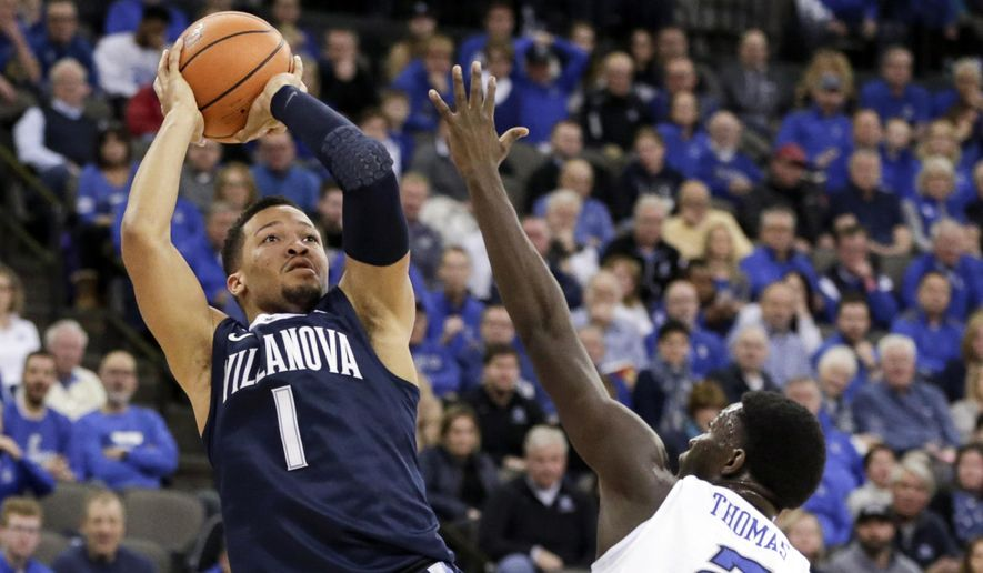 Villanova's Jalen Brunson (1) shoots over Creighton's Khyri Thomas (2) during the first half of an NCAA college basketball game in Omaha, Neb., Saturday, Feb. 24, 2018. (AP Photo/Nati Harnik)