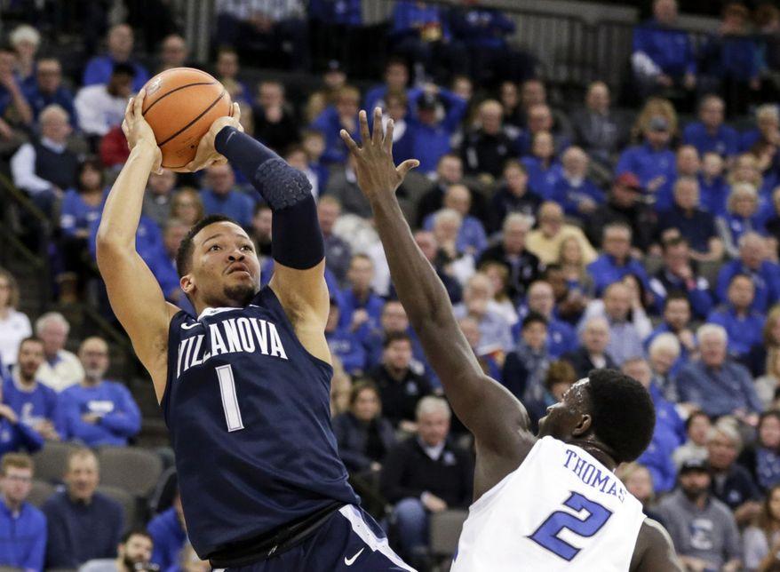 Villanova's Jalen Brunson (1) shoots over Creighton's Khyri Thomas (2) during the first half of an NCAA college basketball game in Omaha, Neb., Saturday, Feb. 24, 2018. (AP Photo/Nati Harnik)