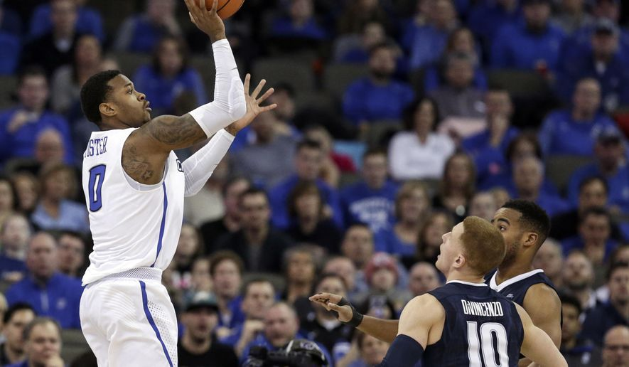 Creighton's Marcus Foster (0) shoots over Villanova's Donte DiVincenzo (10) and Villanova's Mikal Bridges, right rear, in overtime in an NCAA college basketball game against Villanova in Omaha, Neb., Saturday, Feb. 24, 2018. Foster scored 28 points in Creighton's 89-83 overtime win. (AP Photo/Nati Harnik)