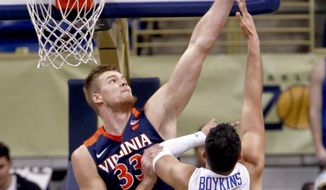 Virginia's Jack Salt, left, blocks a shot by Pittsburgh's Monty Boykins (33) during the first half of an NCAA college basketball game, Saturday, Feb. 24, 2018, in Pittsburgh. (AP Photo/Keith Srakocic)