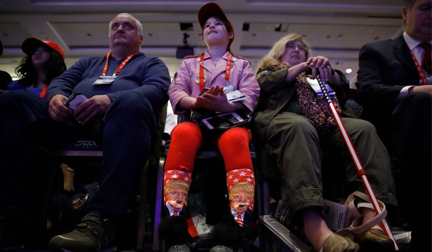 Millie March, 12, of Fairfax, Virginia, showed off her socks with the image of President Trump while awaiting his speech. (Associated Press)