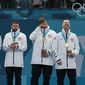United States' curlers (from left) Joe Polo, John Landsteiner, Matt Hamilton, Tyler George, John Shuster and captain Phill Drobnick won the first gold medal in team history by topping Sweden. It was only the Americans' second curling medal — with the first coming in a bronze-medal game at the 2006 Turin Games. (Associated Press)