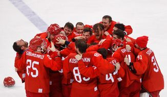 Olympic athletes from Russia celebrate after winning the hockey gold medal against Germany, 4-3, on Sunday. (ASSOCIATED PRESS)