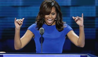 First Lady Michelle Obama waves to delegates during the first day of the Democratic National Convention in Philadelphia , Monday, July 25, 2016. (AP Photo/J. Scott Applewhite)
