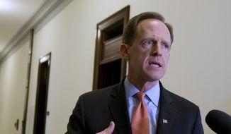 In this April 12, 2016, file photo, Sen. Patrick J. Toomey, R-Pa., speaks to reporters outside his office on Capitol Hill, in Washington.  (AP Photo/Manuel Balce Ceneta, File)