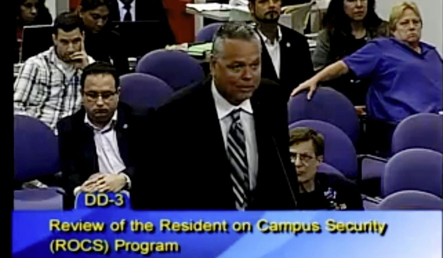 """This Feb. 18, 2015 image taken from video provided by Broward County Public Schools shows school resource officer Scot Peterson during a school board meeting of Broward County, Fla. During the shootings at Marjory Stoneman Douglas High School on Feb. 14, 2018, Peterson took up a position viewing the western entrance of the building for more than four minutes after the shooting started, but """"he never went in,"""" Broward County Sheriff Scott Israel said at a news conference.  Peterson, was suspended without pay and placed under investigation, then chose to resign, Israel said  (Broward County Public Schools via AP)"""