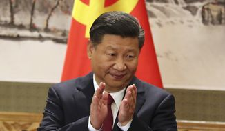 FILE - In this Oct 25, 2017, file photo, Chinese President Xi Jinping claps while addressing the media as he introduces new members of the Politburo Standing Committee at Beijing's Great Hall of the People. On a proposal made public Sunday, Feb. 25, 2018, China's ruling Communist Party proposes removing a limit of two consecutive terms for the president and vice president. (AP Photo/Ng Han Guan, File)