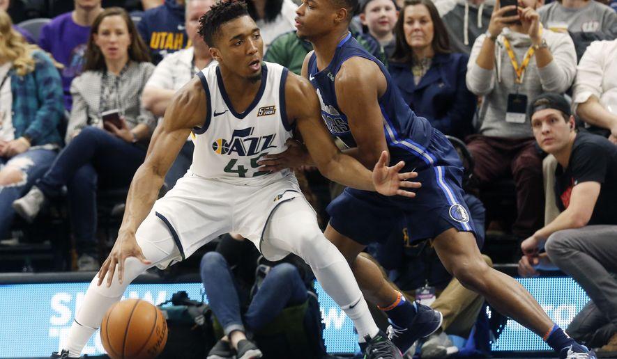 2b91d37dc563 Utah Jazz s Donovan Mitchell (45) looks for an opening as Dallas Mavericks   Dennis Smith Jr.