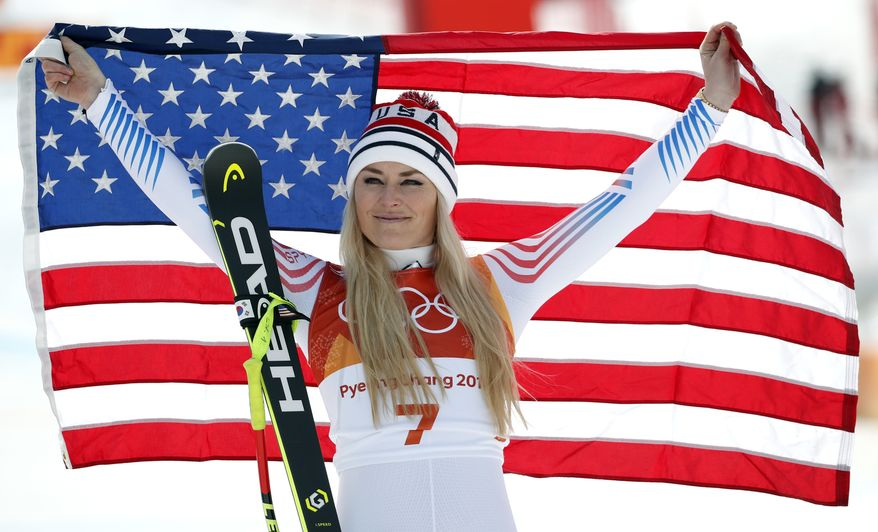 FILE - In this Feb. 21, 2018 file photo, bronze medal winner Lindsey Vonn, of the United States, celebrates during the flower ceremony for the women's downhill at the 2018 Winter Olympics in Jeongseon, South Korea. With Vonn and Ted Ligety likely on the way out, alpine skiing is heading for a major changing of the guard after winning just one gold and three medals at these games.  That was the fewest U.S. victories since 2002, the fewest podium finishes since 2006.  (AP Photo/Christophe Ena, File) **FILE**