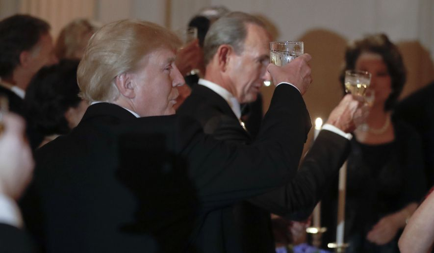 President Donald Trump raises his glass during a toast at the Governors' Ball in the State Dining Room of the White House in Washington, Sunday, Feb. 25, 2018. (AP Photo/Pablo Martinez Monsivais)