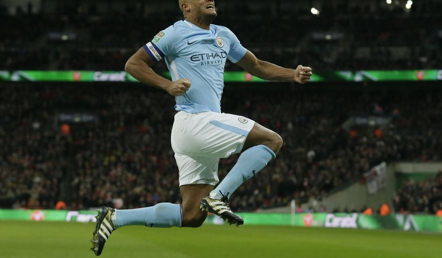 Manchester City's Vincent Kompany celebrates after he scores his sides 2nd goal of the game during the English League Cup Final between Arsenal and Manchester City at Wembley stadium in London, Sunday, Feb. 25, 2018.(AP Photo/Tim Ireland)