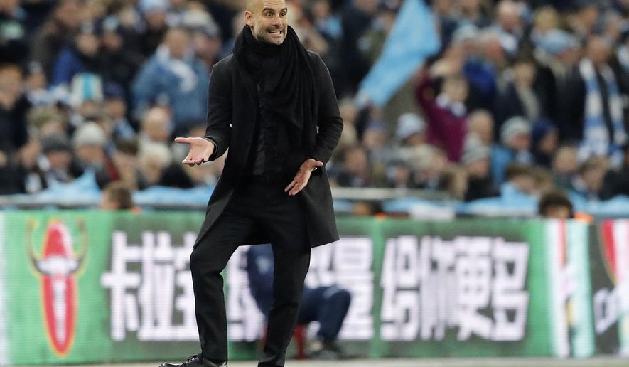 Manchester City coach Pep Guardiola gestures during the English League Cup final soccer match between Arsenal and Manchester City at Wembley stadium in London, Sunday, Feb. 25, 2018. (AP Photo/Frank Augstein)