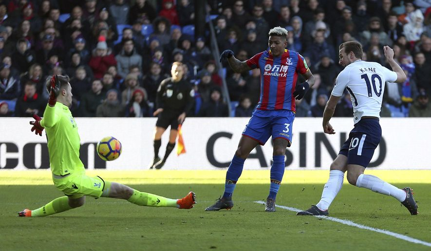 Tottenham Hotspur's Harry Kane, right, attempts a shot on goal during the English Premier League soccer match between Crystal Palace and Tottenham Hotspur at Selhurst Park, London, Sunday, Feb. 25, 2018. (Steven Paston/PA via AP)