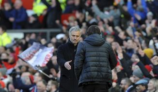 Manchester United coach Jose Mourinho, left, shakes hands with Chelsea's team manager Antonio Conte at the end of the English Premier League soccer match between Manchester United and Chelsea at the Old Trafford stadium in Manchester, England, Sunday, Feb. 25, 2018. (AP Photo/Rui Vieira)