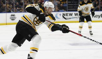 Boston Bruins forward Rick Nash (61) shoots during the first period of an NHL hockey game against the Buffalo Sabres, Sunday, Feb. 25, 2018, in Buffalo, N.Y. (AP Photo/Jeffrey T. Barnes)
