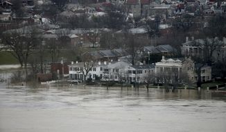 The Ohio River overflows the Covington, Ky., waterfront Sunday, Feb. 25, 2018. Far left of the photo is the Licking river. Heavy rains overnight have sent the swollen Ohio River at Cincinnati to its highest point in 20 years with the river expected to remain above flood stage through the end of the week, a National Weather Service meteorologist said Sunday. (Cara Owsley/The Cincinnati Enquirer via AP)
