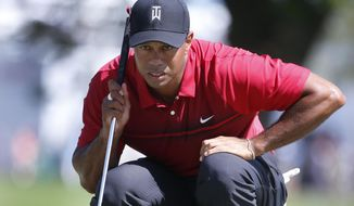 Tiger Woods lines up a putt on the fourth hole during the final round of the Honda Classic golf tournament, Sunday, Feb. 25, 2018, in Palm Beach Gardens, Fla. (AP Photo/Wilfredo Lee)
