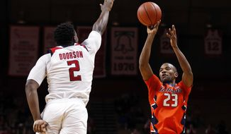 Illinois guard Aaron Jordan (23) shoots over Rutgers center Shaquille Doorson (2) during the first half of an NCAA college basketball game Sunday, Feb. 25, 2018, in Piscataway, N.J. Illinois defeated Rutgers 75-62. (AP Photo/Adam Hunger)