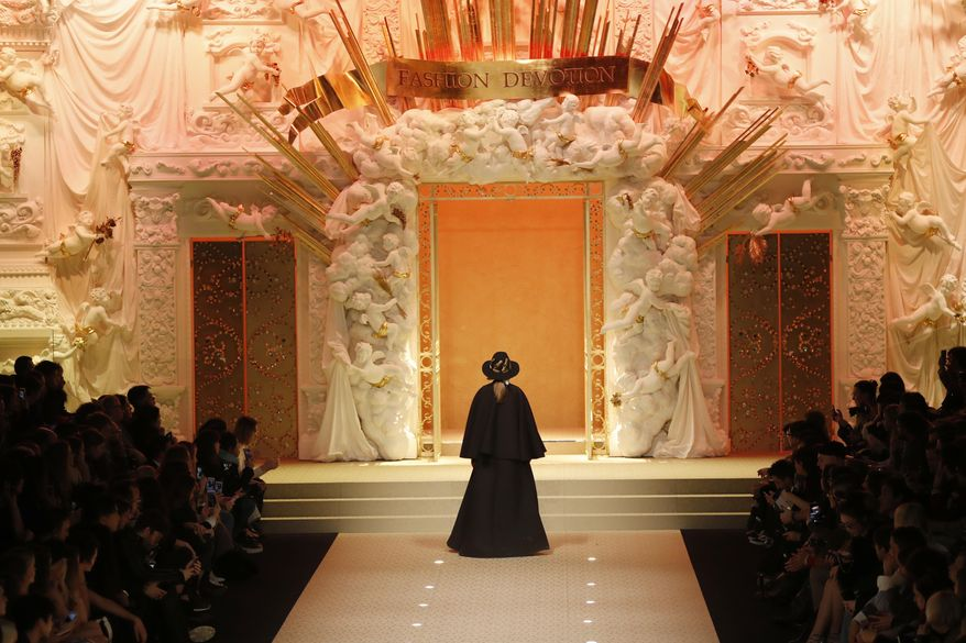 A model wears a creation as part of the Dolce & Gabbana women's Fall/Winter 2018-2019 collection, presented during the Milan Fashion Week, in Milan, Italy, Sunday, Feb. 25, 2018. (AP Photo/Antonio Calanni)
