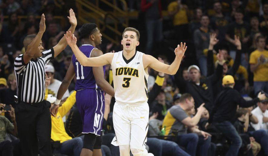 Iowa's Jordan Bohannon celebrates a 3-pointer during the Hawkeyes' game against Northwestern in Iowa City, Iowa, Sunday, Feb. 25, 2018. (James Capen/Iowa City Press-Citizen via AP) **File**