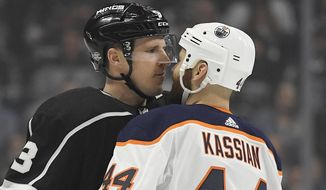 Los Angeles Kings defenseman Dion Phaneuf, left, and Edmonton Oilers right wing Zack Kassian face off during the first period of an NHL hockey game, Saturday, Feb. 24, 2018, in Los Angeles. (AP Photo/Mark J. Terrill)