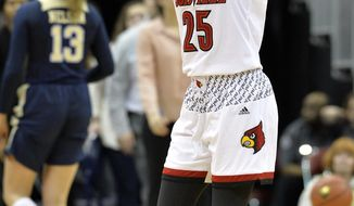 Louisville guard Asia Durr (25) attempts to get the crowd into the game during the first half of an NCAA college basketball game against Pittsburgh, Sunday, Feb. 25, 2018, in Louisville, Ky. (AP Photo/Timothy D. Easley)