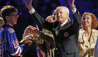 New York Rangers Hall of Famer Jean Ratelle gestures toward the crowd at a ceremony retiring his jersey number 19 before an NHL hockey game between the New York Rangers and Detroit Red Wings at Madison Square Garden in New York, Sunday, Feb. 25, 2018. Ratelle, who played parts of 16 of his 21 NHL seasons with the Rangers, entered the Hockey Hall of Fame in 1985 and is second on the Rangers' goals list with 336 and third in assists with 481 and points with 817. (AP Photo/Kathy Willens)