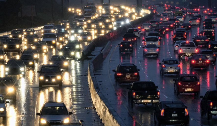 In this Jan. 12, 2017 file photo, early morning rush hour traffic crawls along the Hollywood Freeway toward downtown Los Angeles. (AP Photo/Richard Vogel, File)