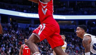 Houston Rockets guard James Harden goes up to shoot against the Denver Nuggets during the second quarter of an NBA basketball game, Sunday, Feb. 25, 2018, in Denver. (AP Photo/Jack Dempsey)
