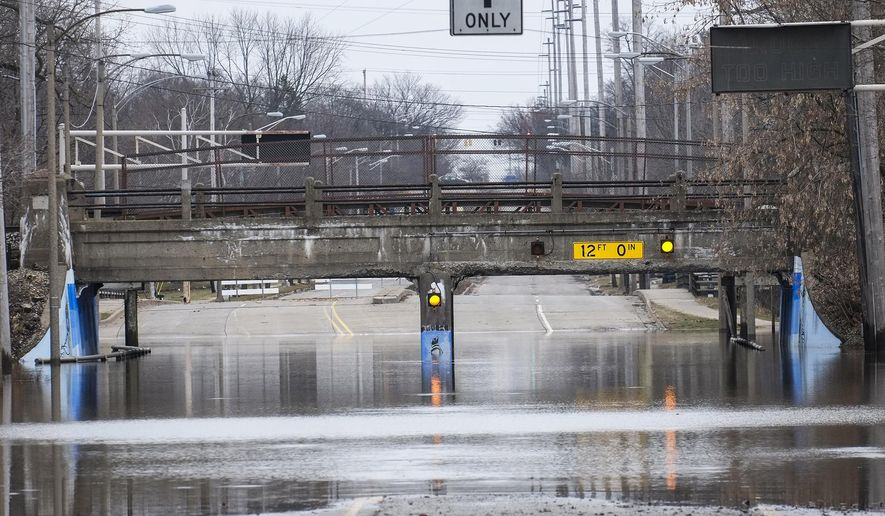 Pennsylvania Avenue at the Potter Park Zoo entrance is still closed due to flooding, Saturday, Feb. 24, 2018 in Lansing, Mich. (Robert Killips /Lansing State Journal via AP)