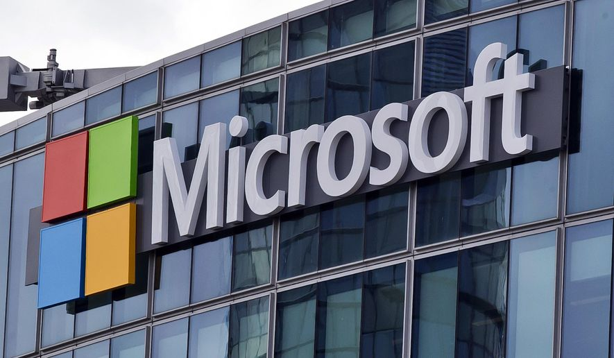 FILE - This April 12, 2016, file photo shows the Microsoft logo in Issy-les-Moulineaux, outside Paris, France. Microsoft has an eye on its international customers as it confronts the Trump administration in a Supreme Court fight about turning over emails to investigators. The justices will hear arguments Feb. 26, 2018, over whether the company, as part of an international drug trafficking investigation, must comply with an American warrant for emails stored on a server in a Microsoft facility in Dublin, Ireland.(AP Photo/Michel Euler, File)