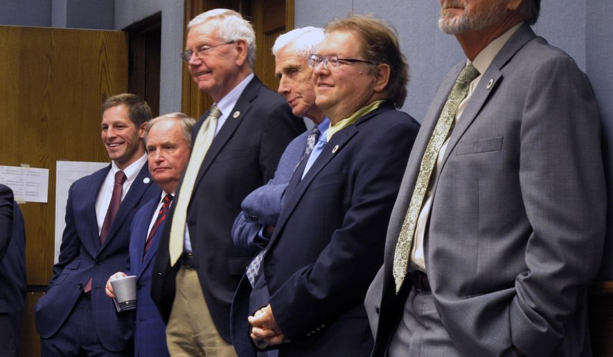 Lawmakers listen to the testimony and watch the votes on tax bills during the House Ways and Means Committee on Sunday, Feb. 25, 2018, in Baton Rouge, La. (AP Photo/Melinda Deslatte)