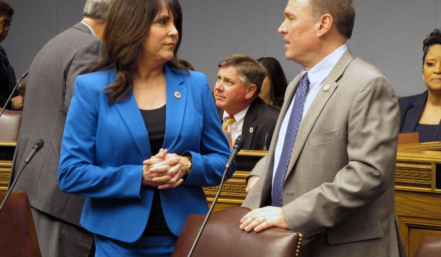 Reps. Dodie Horton, R-Haughton, left, and Alan Seabaugh, R-Shreveport, talk ahead of the House Ways and Means Committee hearing, on Sunday, Feb. 25, 2018, in Baton Rouge, La. The lawmakers voted against both major tax bills advanced by the committee. (AP Photo/Melinda Deslatte)