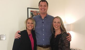 This photo provided by Matt White shows him with Jacoba Ballard, left, and Julie Harmon in New York before a television interview. The three one-time strangers have also reached out to 21 other men and women, all in their 30s, who've been linked through DNA tests as their half-siblings, which they claim is evidence that former fertility doctor Donald Cline is likely their biological father.  (Courtesy Matt White via AP)