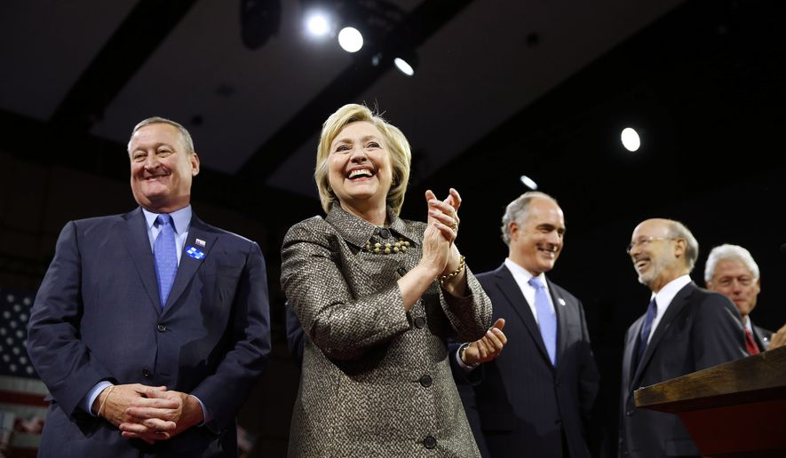 Democratic presidential candidate Hillary Clinton is accompanied by Philadelphia Mayor Jim Kenney, left, Sen. Bob Casey D-Pa., Gov. Tom Wolf, and former President Bill Clinton, stands on stage at her presidential primary election night rally, Tuesday, April 26, 2016, in Philadelphia. (AP Photo/Matt Rourke)