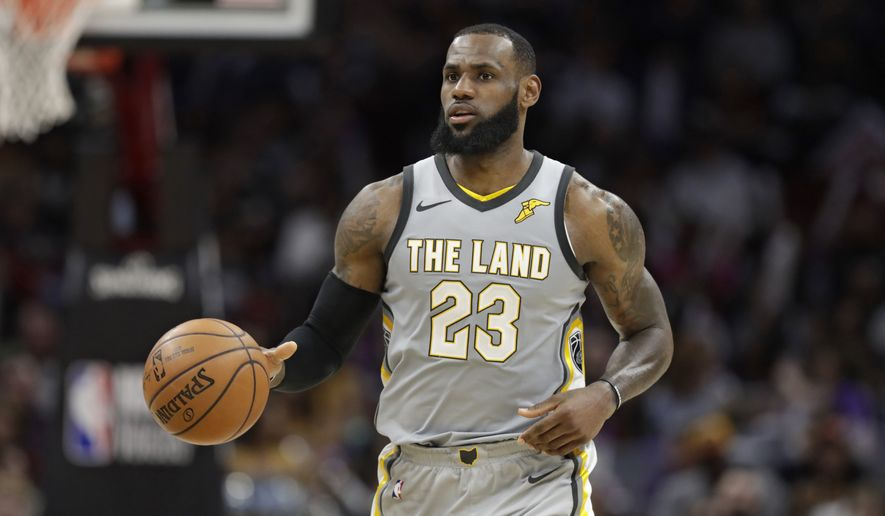 Cleveland Cavaliers' LeBron James drives against the San Antonio Spurs in the second half of an NBA basketball game, Sunday, Feb. 25, 2018, in Cleveland. (AP Photo/Tony Dejak)