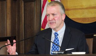 U.S. Sen. Dan Sullivan, R-Alaska, speaks to reporters after delivering an address to a joint session of the Alaska Legislature on Monday, Feb. 26, 2018, in Juneau, Alaska. During the news conference, Sullivan said the discussion over mass shootings needs to be broader than guns and cited concerns about violence in video games and movies. (AP Photo/Becky Bohrer)