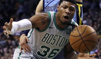 Boston Celtics guard Marcus Smart (36) is fouled by Memphis Grizzlies forward Dillon Brooks, top, on a drive to the basket during the first quarter of an NBA basketball game in Boston, Monday, Feb. 26, 2018. (AP Photo/Charles Krupa)