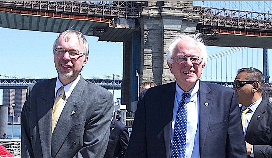 Levi Sanders, shown here with his father Sen. Bernie Sanders, is eyeing a run for Congress in New Hampshire, using the same progressive policy platform as his father. (AP Photo)