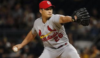 FILE - In this Sept. 23, 2017, file photo, St. Louis Cardinals relief pitcher Seung-Hwan Oh delivers in the eighth inning of a baseball game against the Pittsburgh Pirates in Pittsburgh. Free agent reliever Oh and the Toronto Blue Jays have finalized a one-year contract with a 2018 salary of $1.75 million.The deal announced Monday, Feb. 26, 2018, includes a $2.5 million team option for 2019 that could become guaranteed based on appearances this year. (AP Photo/Gene J. Puskar, File)